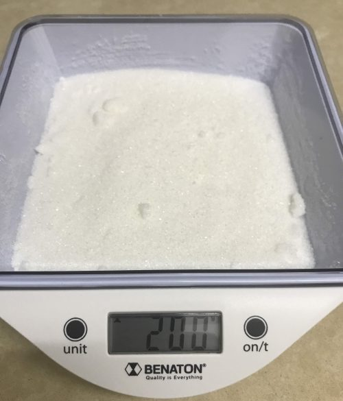 weighting 200gr of granulated sugar